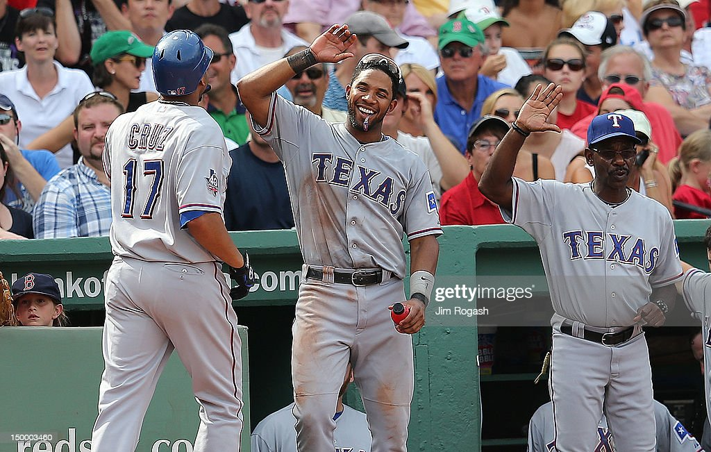 Nelson Cruz #17 of the Texas Rangers celebrates with teammates after he hit a home run in the seventh inning against the Boston Red Sox at Fenway Park August 8, 2012 in Boston, Massachusetts.
