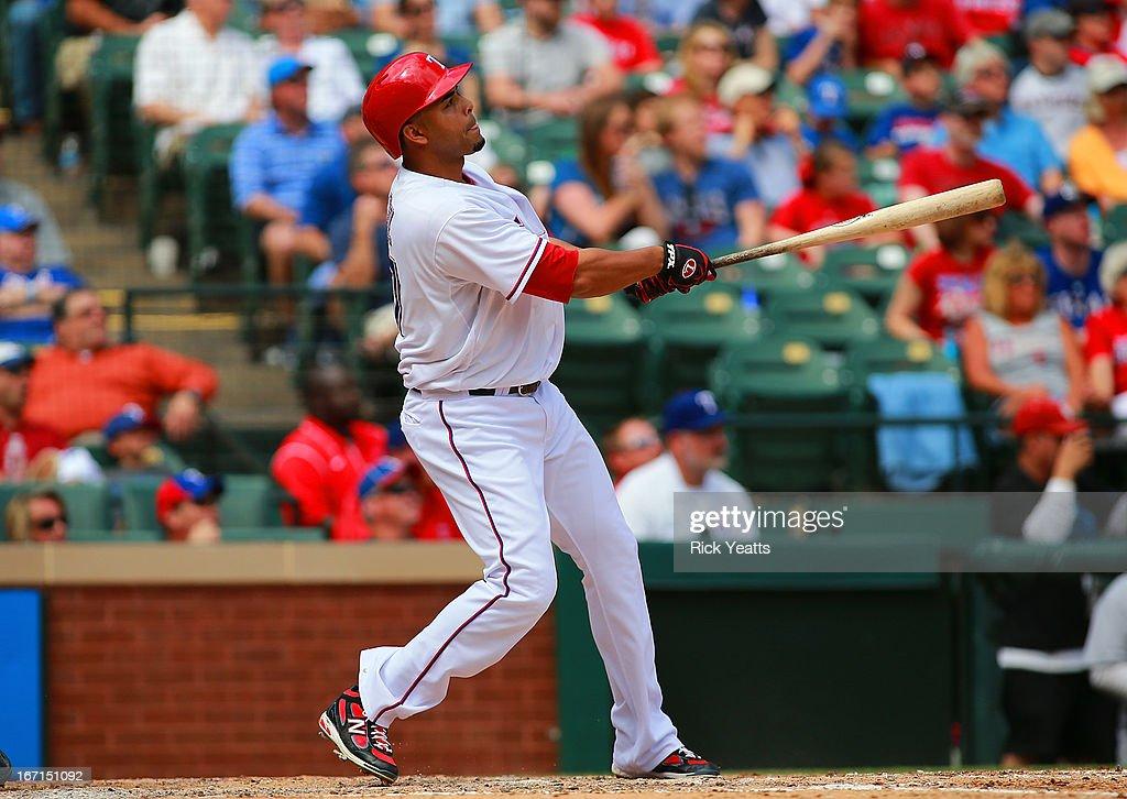 Nelson Cruz #17 of the Texas Rangers hits a grand slam home run in the fifth inning at Rangers Ballpark in Arlington on April 21, 2013 in Arlington, Texas.