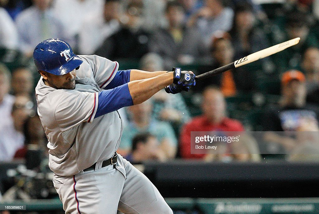 Nelson Cruz #17 of the Texas Rangers hits into a double play in the sixth inning against the Houston Astros as he shatters his bat at Minute Maid Park on April 3, 2013 in Houston, Texas.
