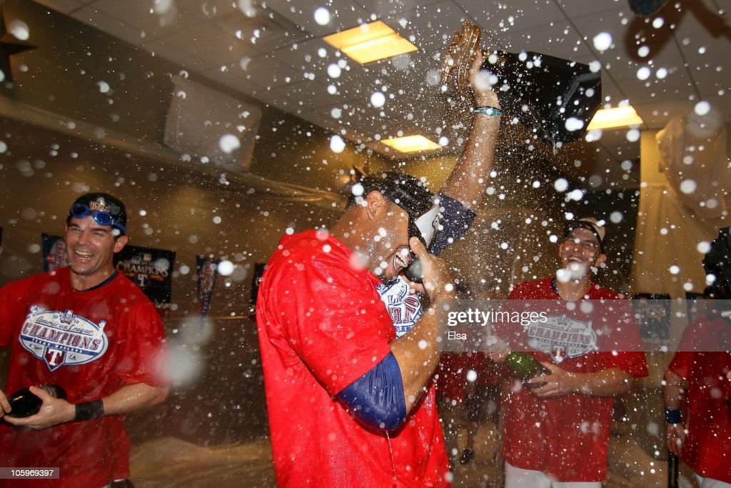 Nelson Cruz #17 of the Texas Rangers holds the Warren C. Giles Trophy in the lockerroom with teammates after defeating the New York Yankees 6-1 in Game Six of the ALCS to advance to the World Series during the 2010 MLB Playoffs at Rangers Ballpark in Arlington on October 22, 2010 in Arlington, Texas.