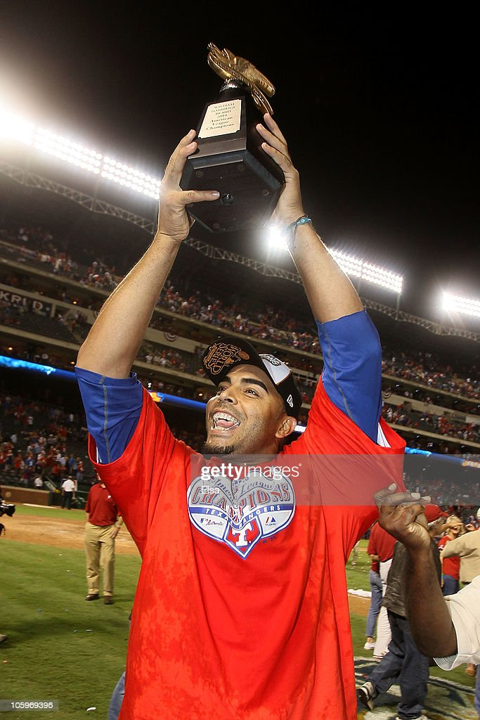 Nelson Cruz #17 of the Texas Rangers holds the Warren C. Giles Trophy after defeating the New York Yankees 6-1 in Game Six of the ALCS to advance to the World Series during the 2010 MLB Playoffs at Rangers Ballpark in Arlington on October 22, 2010 in Arlington, Texas.