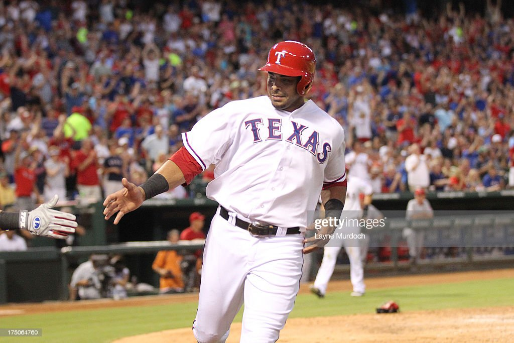 <a gi-track='captionPersonalityLinkClicked' href=/galleries/search?phrase=Nelson+Cruz&family=editorial&specificpeople=235459 ng-click='$event.stopPropagation()'>Nelson Cruz</a> #17 of the Texas Rangers is congratulated by teammate Jeff Baker after scoring a run against the Los Angeles Angels of Anaheim on July 30, 2013 at the Rangers Ballpark in Arlington in Arlington, Texas.