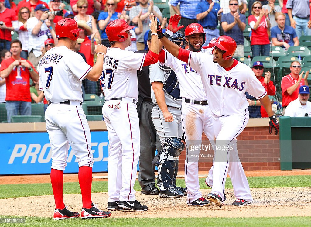 <a gi-track='captionPersonalityLinkClicked' href=/galleries/search?phrase=Nelson+Cruz&family=editorial&specificpeople=235459 ng-click='$event.stopPropagation()'>Nelson Cruz</a> #17 of the Texas Rangers is congratulated on grand slam home run bringing in <a gi-track='captionPersonalityLinkClicked' href=/galleries/search?phrase=Nelson+Cruz&family=editorial&specificpeople=235459 ng-click='$event.stopPropagation()'>Nelson Cruz</a> #17,David Murphy #7 and <a gi-track='captionPersonalityLinkClicked' href=/galleries/search?phrase=Lance+Berkman&family=editorial&specificpeople=167176 ng-click='$event.stopPropagation()'>Lance Berkman</a> #27 against the Seattle Mariners at Rangers Ballpark in Arlington on April 21, 2013 in Arlington, Texas.