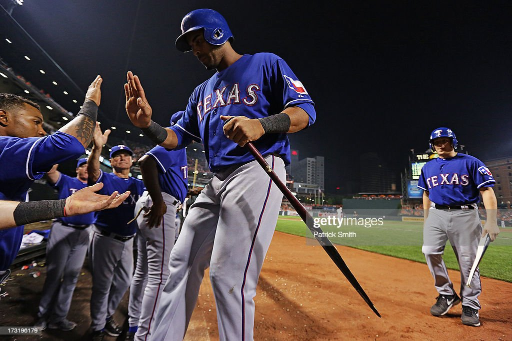 <a gi-track='captionPersonalityLinkClicked' href=/galleries/search?phrase=Nelson+Cruz&family=editorial&specificpeople=235459 ng-click='$event.stopPropagation()'>Nelson Cruz</a> #17 of the Texas Rangers is greeted in the dugout after scoring off of teammate Adrian Beltre (not pictured) against the Baltimore Orioles in the ninth inning at Oriole Park at Camden Yards on July 9, 2013 in Baltimore, Maryland. The Texas Rangers won, 8-4.