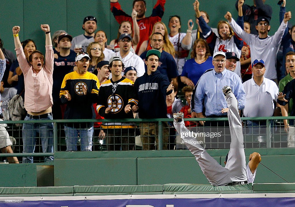 <a gi-track='captionPersonalityLinkClicked' href=/galleries/search?phrase=Nelson+Cruz&family=editorial&specificpeople=235459 ng-click='$event.stopPropagation()'>Nelson Cruz</a> #17 of the Texas Rangers leaps over the right field wall but is unable to catch a home run hit by Mike Carp #37 of the Boston Red Sox in the 5th inning during a game at Fenway Park on June 4, 2013 in Boston, Massachusetts.