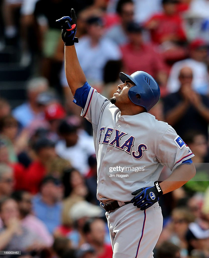 Nelson Cruz #17 of the Texas Rangers reacts after he hit a home run in the seventh inning against the Boston Red Sox at Fenway Park August 8, 2012 in Boston, Massachusetts.
