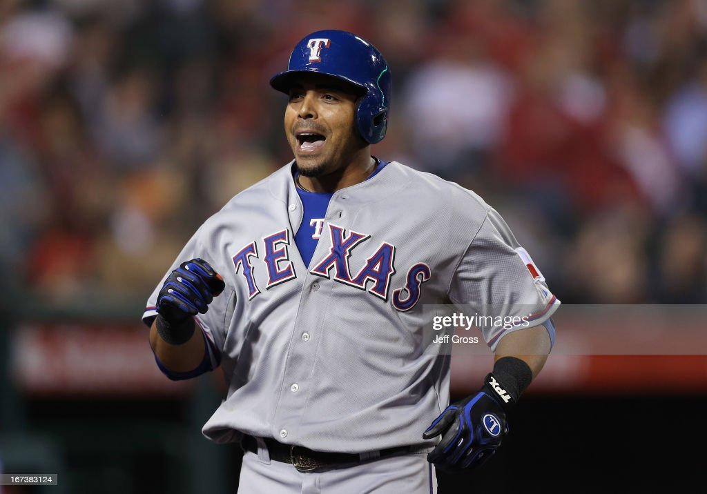 <a gi-track='captionPersonalityLinkClicked' href=/galleries/search?phrase=Nelson+Cruz&family=editorial&specificpeople=235459 ng-click='$event.stopPropagation()'>Nelson Cruz</a> #17 of the Texas Rangers reacts after hitting a three-run home run in the fourth inning against the Los Angeles Angels of Anaheim at Angel Stadium of Anaheim on April 24, 2013 in Anaheim, California.