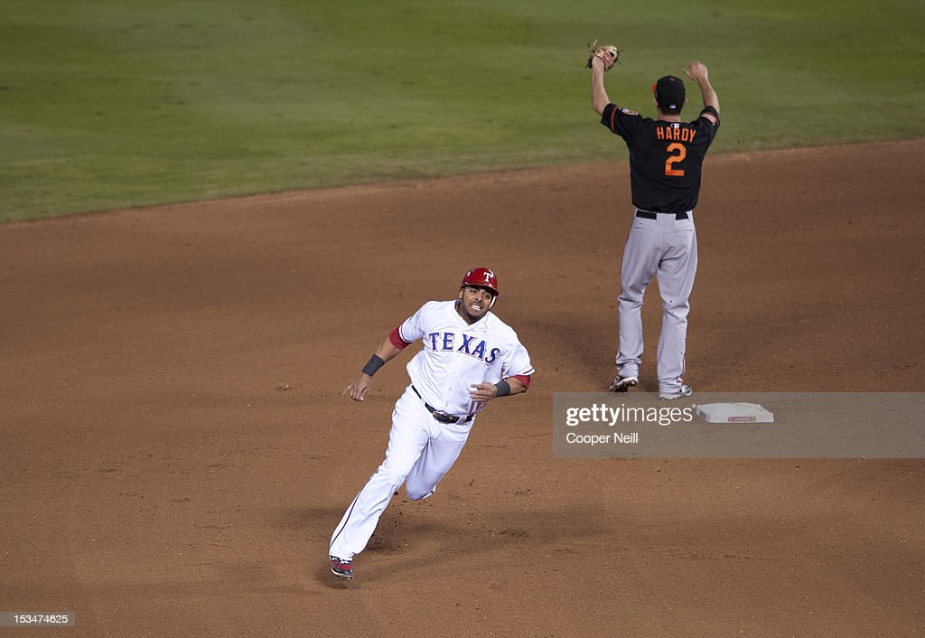 <a gi-track='captionPersonalityLinkClicked' href=/galleries/search?phrase=Nelson+Cruz&family=editorial&specificpeople=235459 ng-click='$event.stopPropagation()'>Nelson Cruz</a> #17 of the Texas Rangers rounds second base during the American League Wild Card game against the Baltimore Orioles on October 5, 2012 at the Rangers Ballpark in Arlington in Arlington, Texas.