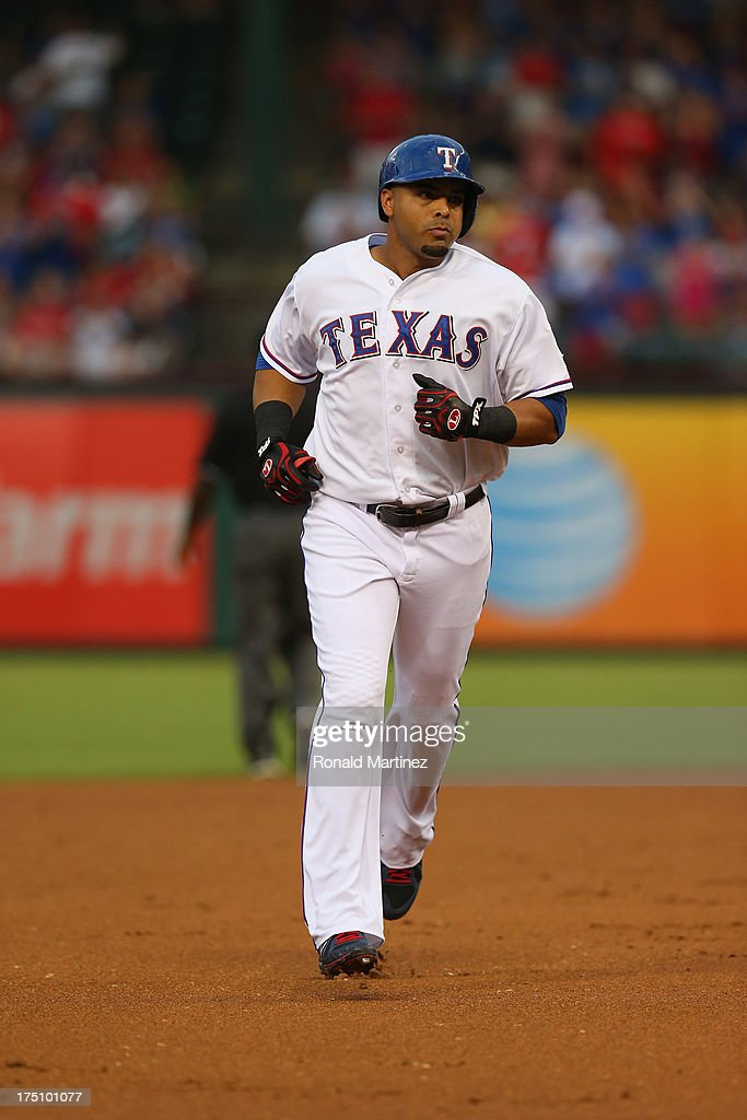 Nelson Cruz #17 of the Texas Rangers runs after hitting a solo homerun against the Los Angeles Angels at Rangers Ballpark in Arlington on July 31, 2013 in Arlington, Texas.