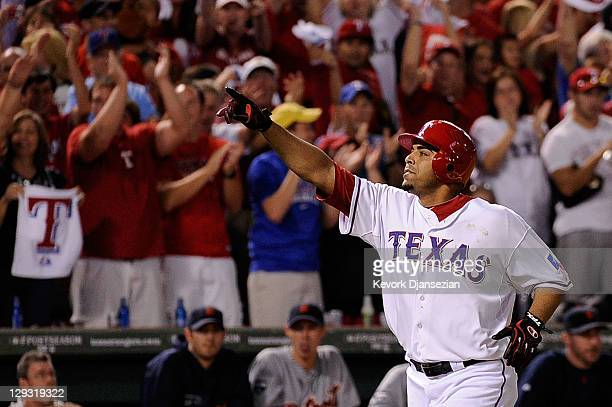 Nelson Cruz of the Texas Rangers runs the bases after hitting a tworun home run in the seventh inning of Game Six of the American League Championship...