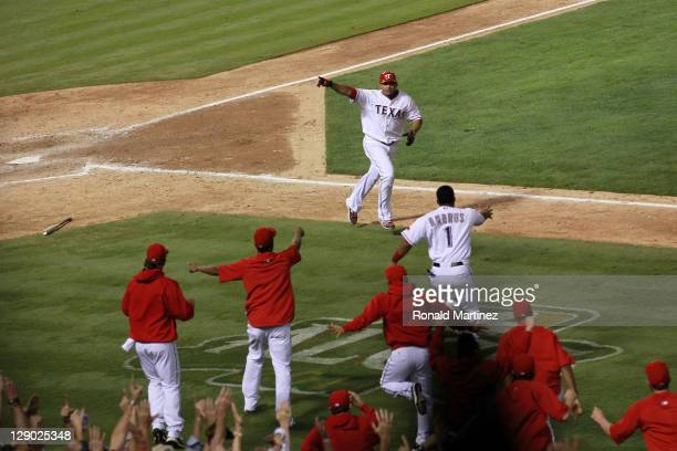 Nelson Cruz of the Texas Rangers runs the bases after hitting a walk off grand slam home run in the bottom of the 11th inning to win Game Two of the...