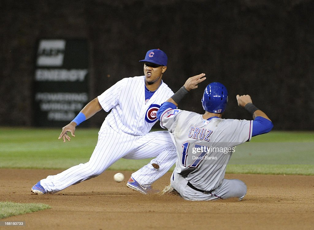 <a gi-track='captionPersonalityLinkClicked' href=/galleries/search?phrase=Nelson+Cruz&family=editorial&specificpeople=235459 ng-click='$event.stopPropagation()'>Nelson Cruz</a> #17 of the Texas Rangers steals second base as <a gi-track='captionPersonalityLinkClicked' href=/galleries/search?phrase=Starlin+Castro&family=editorial&specificpeople=5970945 ng-click='$event.stopPropagation()'>Starlin Castro</a> #13 of the Chicago Cubs takes the throw during the fourth inning on May 6, 2013 at Wrigley Field in Chicago, Illinois.