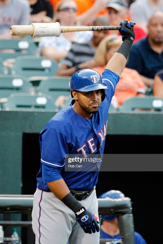 <a gi-track='captionPersonalityLinkClicked' href=/galleries/search?phrase=Nelson+Cruz&family=editorial&specificpeople=235459 ng-click='$event.stopPropagation()'>Nelson Cruz</a> #17 of the Texas Rangers waits to bat during the first inning against the Baltimore Orioles at Oriole Park at Camden Yards on July 10, 2013 in Baltimore, Maryland.