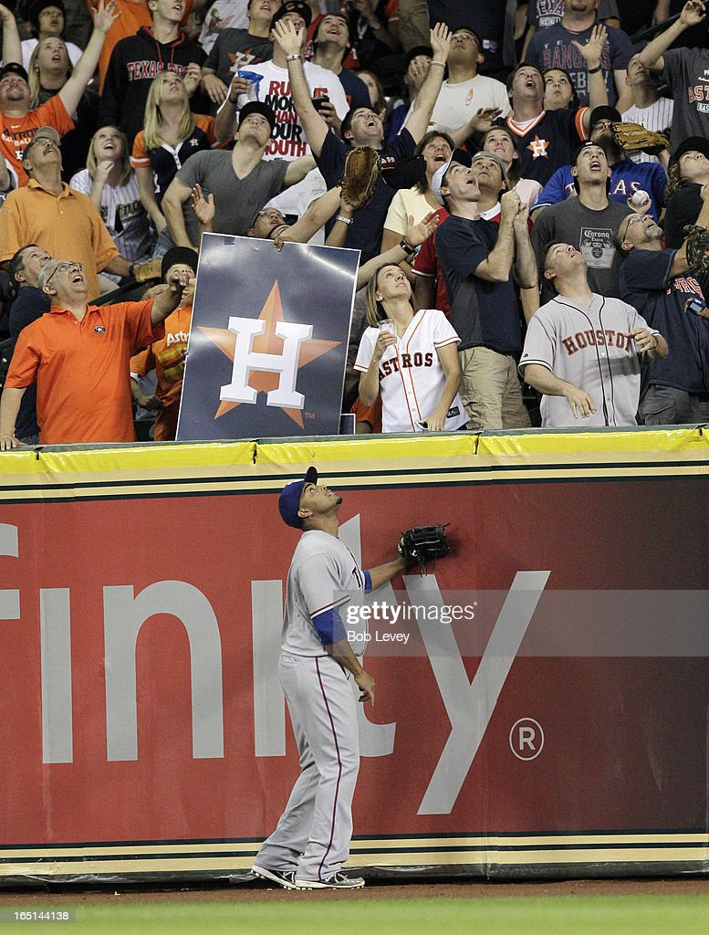 Nelson Cruz #17 of the Texas Rangers watches the ball leave the park on a Rick Ankiel #28 of the Houston Astros three run home run in the sixth inning on Opening Day at Minute Maid Park on March 31, 2013 in Houston, Texas.