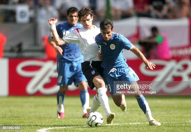 Nelson Cuevas Paraguay and Owen Hargreaves England battle for the ball