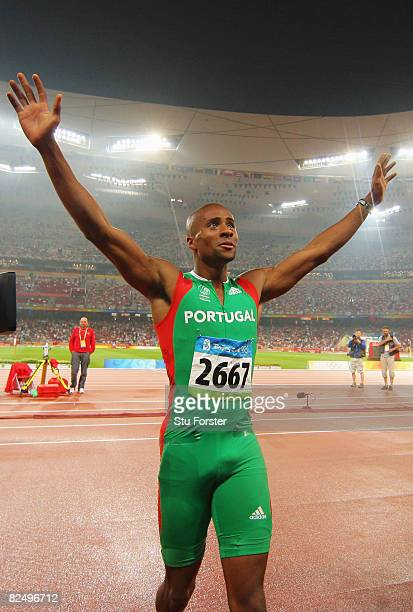 Nelson Evora of Portugal celebrates winning the Men's Triple Jump Final and the gold medal held at the National Stadium during Day 13 of the Beijing...