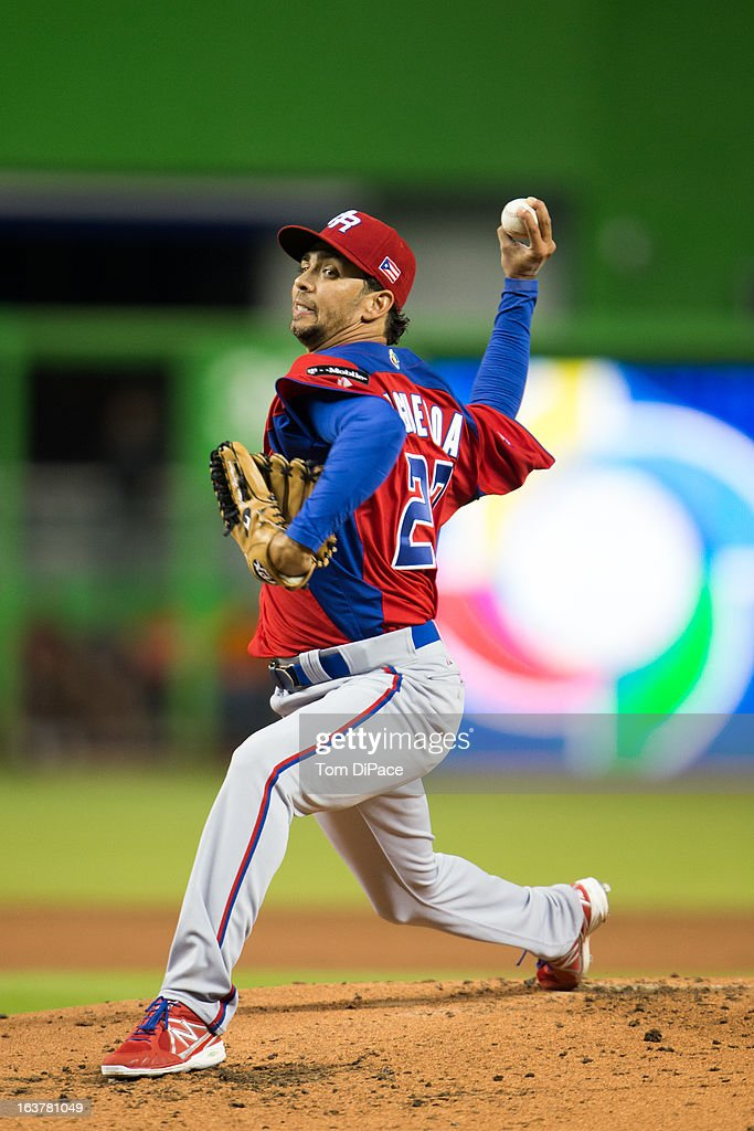 Nelson Figueroa #27 of Team Puerto Rico pitches during Pool 2, Game 4 against Team USA in the second round of the 2013 World Baseball Classic on Friday, March 15, 2013 at Marlins Park in Miami, Florida.
