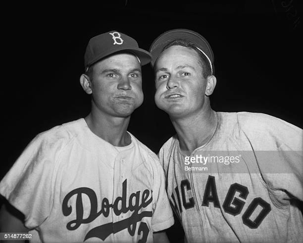Nelson Fox of the Brooklyn Dodgers and Don Zimmer of the Chicago White Sox chewing tobacco