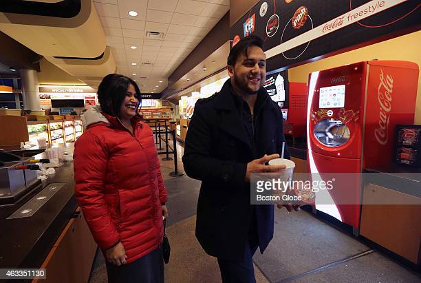 Nelson Fuentes of Everett Mass and Lidiann Lopez of Ipswich Mass purchase food at the AMC Assembly Row theater