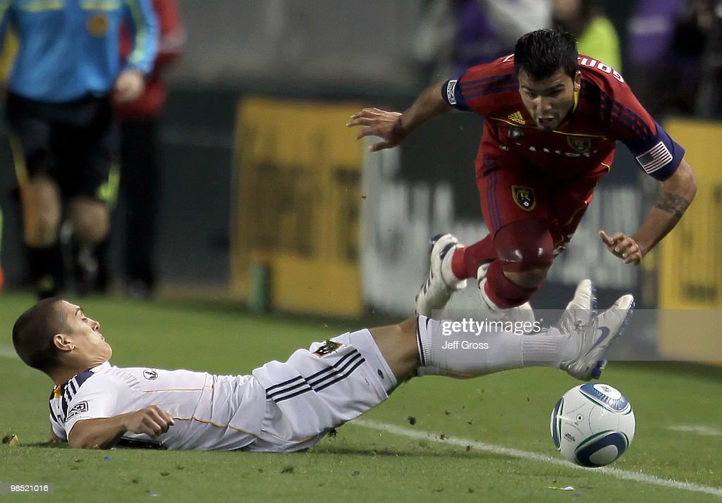 Nelson Gonzalez #22 of Real Salt Lake is tackled by Bryan Jordanl #27 of the Los Angeles Galaxy in the first half at the Home Depot Center on April 17, 2010 in Carson, California.