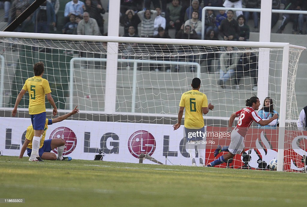 <a gi-track='captionPersonalityLinkClicked' href=/galleries/search?phrase=Nelson+Haedo+Valdez&family=editorial&specificpeople=556805 ng-click='$event.stopPropagation()'>Nelson Haedo Valdez</a> of Paraguay celebrate a goal against Brasil during a match as part of group B of 2011 Copa America at the Mario Kempes Stadium on July 09, 2011 in Cordoba, Argentina.