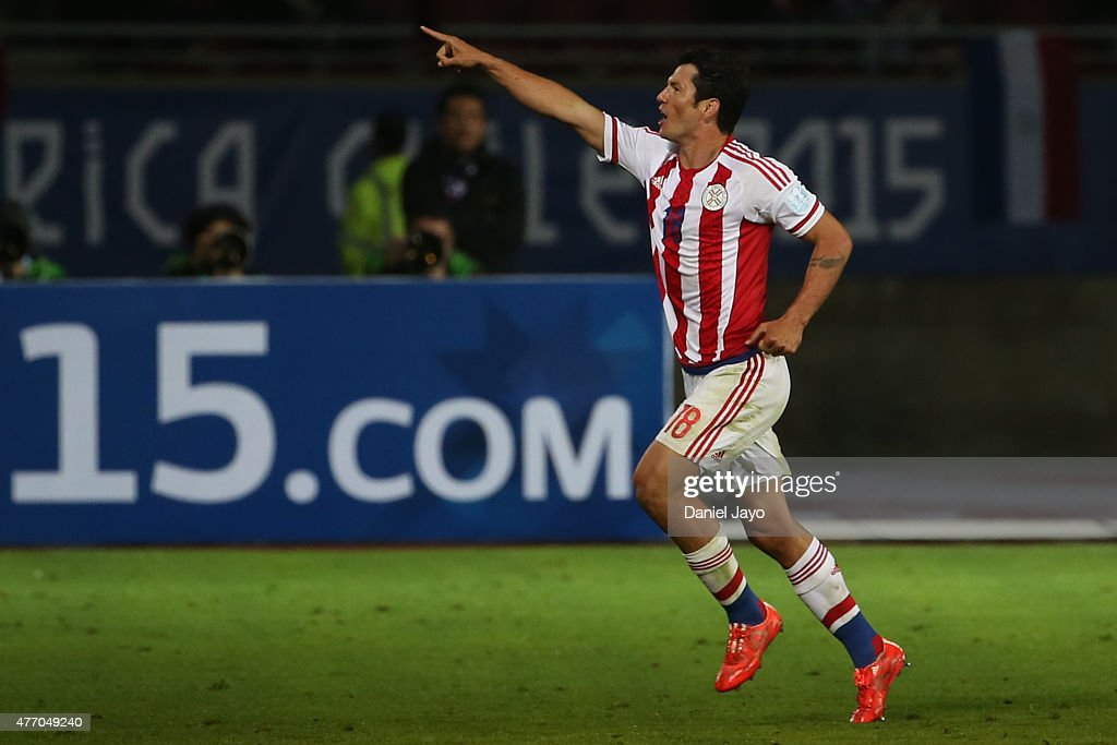 <a gi-track='captionPersonalityLinkClicked' href=/galleries/search?phrase=Nelson+Haedo+Valdez&family=editorial&specificpeople=556805 ng-click='$event.stopPropagation()'>Nelson Haedo Valdez</a> of Paraguay celebrates after scoring the first goal of his team during the 2015 Copa America Chile Group B match between Argentina and Paraguay at La Portada Stadium on June 13, 2015 in La Serena, Chile.