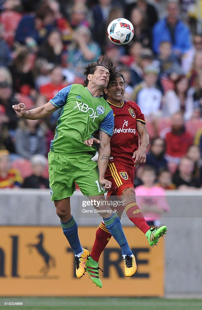 Nelson Haedo Valdez #16 of Seattle Sounders FC heads the ball away from Tony Beltran #2 of Real Salt Lake in the first half of the 2-1 win by Real Salt Lake at Rio Tinto Stadium on March 12, 2016 in Sandy, Utah.