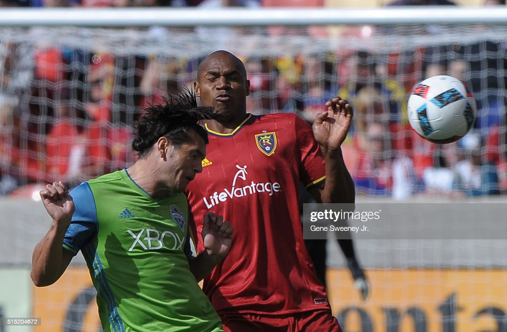 Nelson Haedo Valdez #16 of Seattle Sounders FC heads the ball away from Jamison Olave #4 of Real Salt Lake in the first half of the 2-1 win by Real Salt Lake at Rio Tinto Stadium on March 12, 2016 in Sandy, Utah.