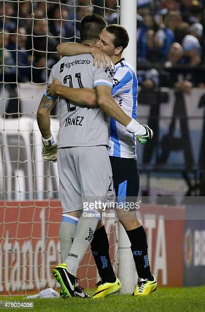 Nelson Ibañez goalkeeper of Racing Club celebrates with his teammate Luciano Aued after saving a penalty during a second leg match between Racing...