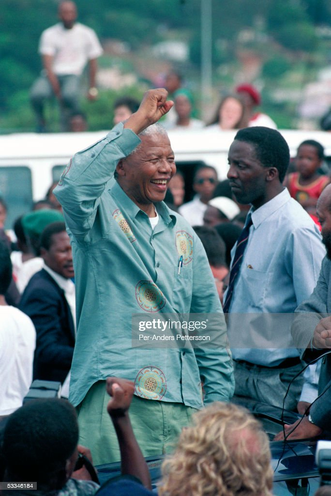 <a gi-track='captionPersonalityLinkClicked' href=/galleries/search?phrase=Nelson+Mandela&family=editorial&specificpeople=118613 ng-click='$event.stopPropagation()'>Nelson Mandela</a> acknowledges a crowd of ANC supporters April 21, 1994 in Durban, South Africa. The pre-election rally is just days before the historic democratic election on April 27, 1994 that Mr. Mandela won. Mr. Mandela became the first black democratic elected president in South Africa. He retired from office after one term in June 1999.