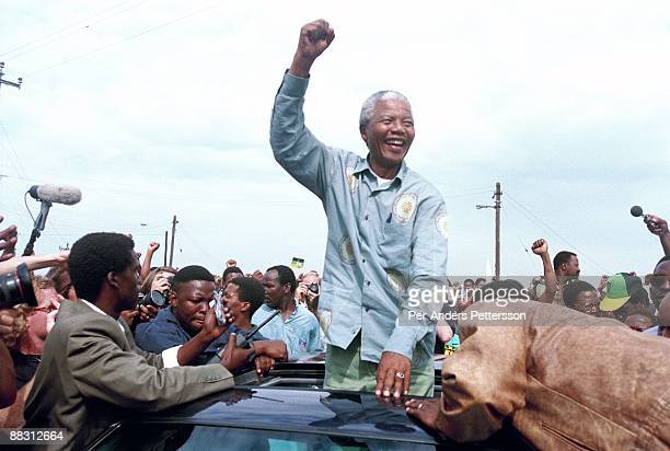 Nelson Mandela acknowledges a crowd of ANC supporters April 21 1994 in Durban South Africa The preelection rally was just days before the historic...