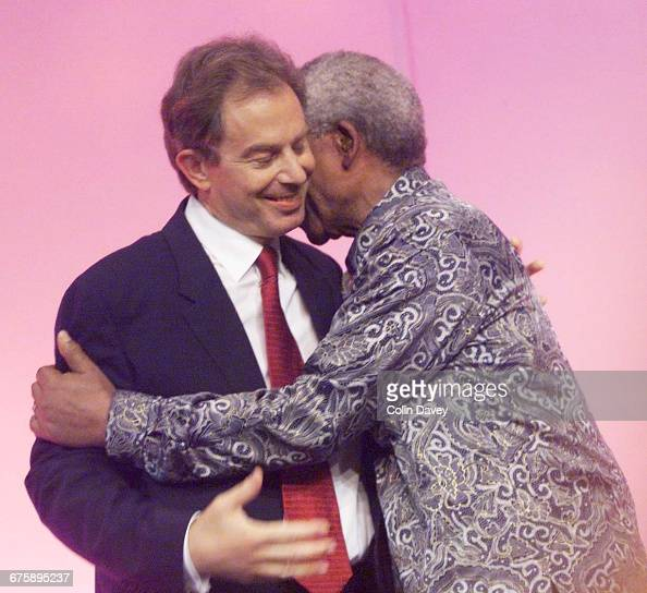 Nelson Mandela and Tony Blair embrace on the last day of the Labour Party Conference Brighton 28th September 2000