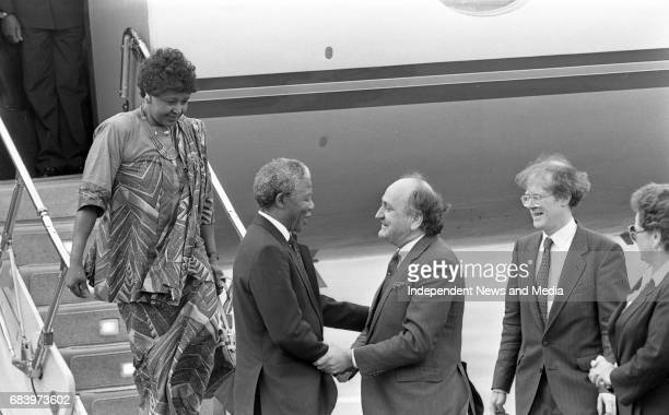 Nelson Mandela arrives at Dublin Airport accompanied by the Minister for Foreign Affairs Gerry Collins