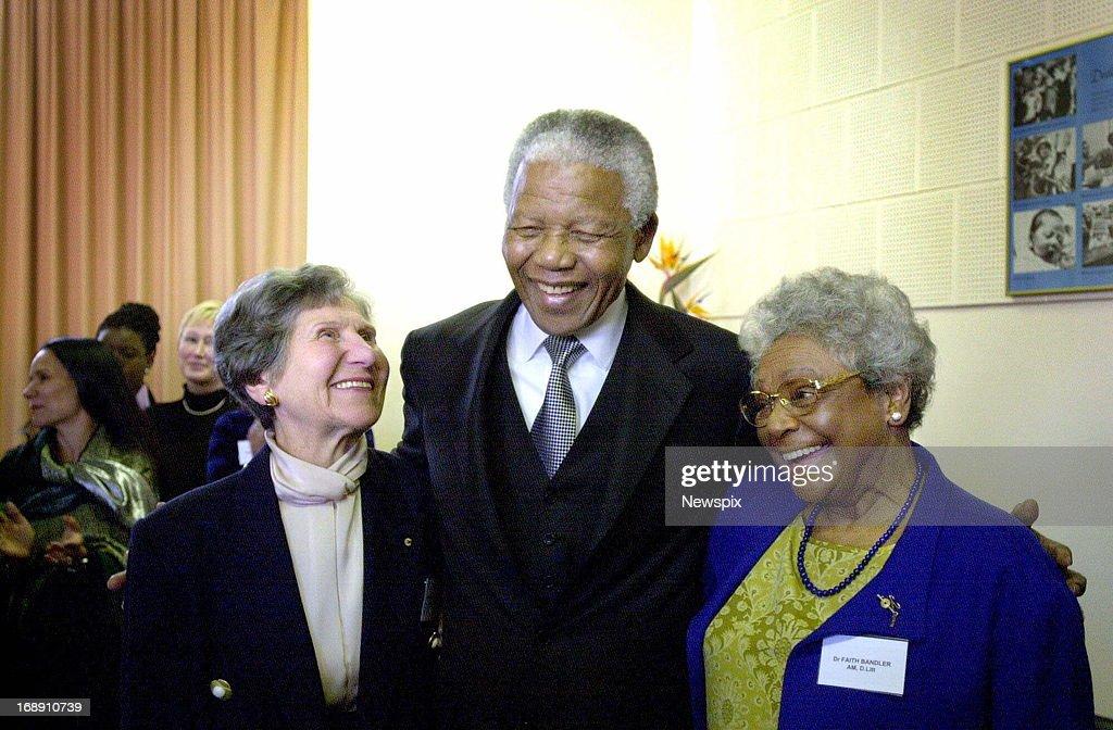 Nelson Mandela at Sydney University awards certificates to Dr Faith Bandler (glasses) and Dr. Stella Cornelius, on September 4, 2000 in Sydney, Australia.