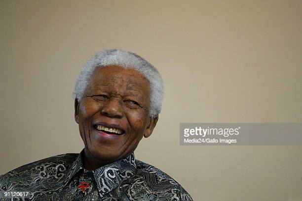 Nelson Mandela chuckles during the launch of a comic book called 'Prisoner in the Garden' at the Nelson Mandela Foundation