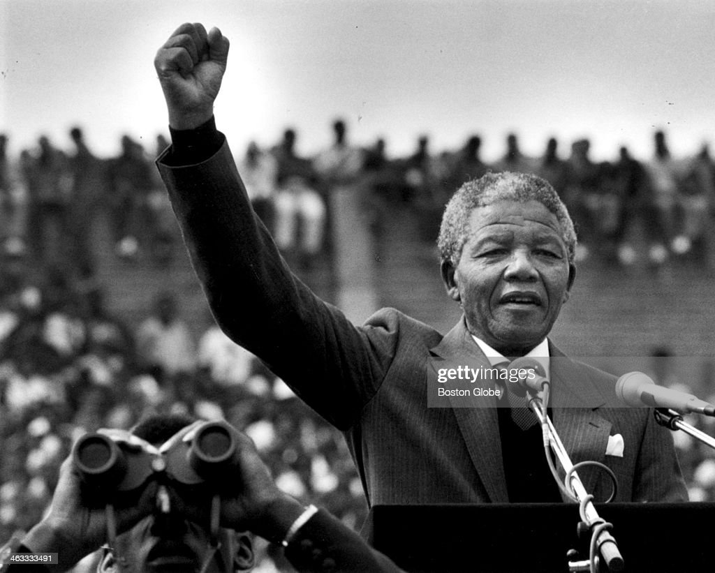 <a gi-track='captionPersonalityLinkClicked' href=/galleries/search?phrase=Nelson+Mandela&family=editorial&specificpeople=118613 ng-click='$event.stopPropagation()'>Nelson Mandela</a> gestured to supporters in Soweto two days after his release from prison in Cape Town. He addressed more than 100,000 people inside a soccer stadium saying, 'during the past 27 years I have looked forward to this day when I would come back to the area I regard as home, to meet my brothers and sisters and grandchildren.'
