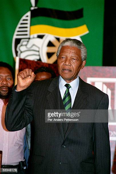 Nelson Mandela of South Africa raises his fist as he celebrates his election victory on May 2 1994 in the Carlton Hotel in Johannesburg South Africa...