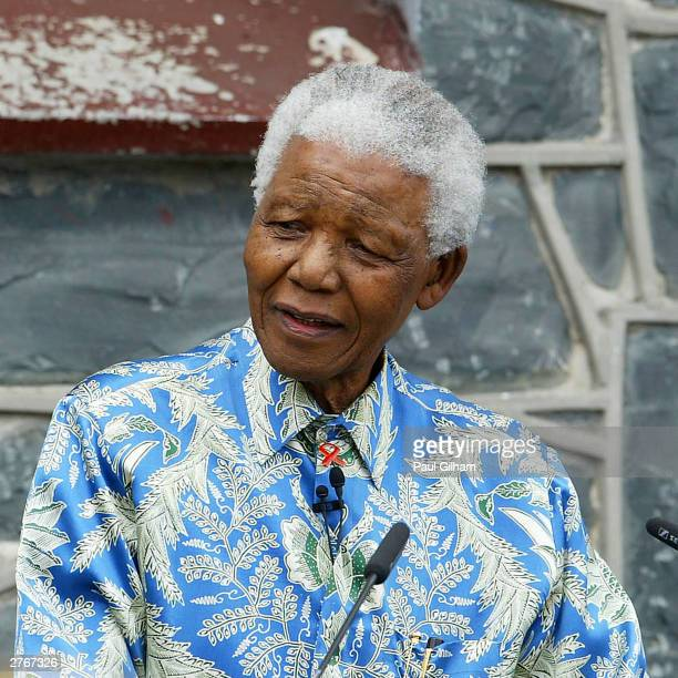Nelson Mandela outside his former prison cell attends a press conference for '46664 Give One Minute of Your Life to AIDS' on November 28 2003 on...