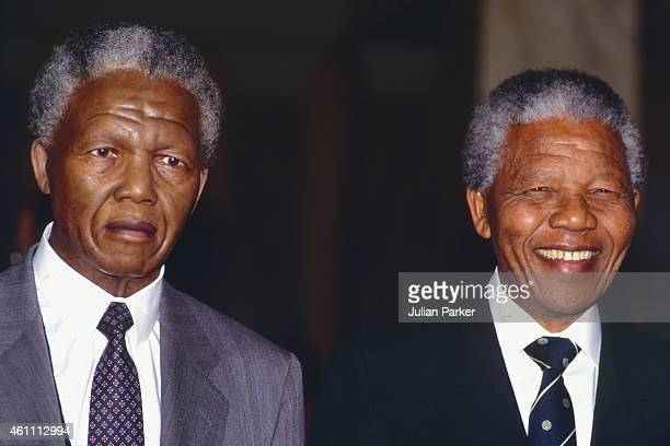 Nelson Mandela poses next to his waxwork replica at Madame Tussaud's in London on April 25 1991 in London United Kingdom