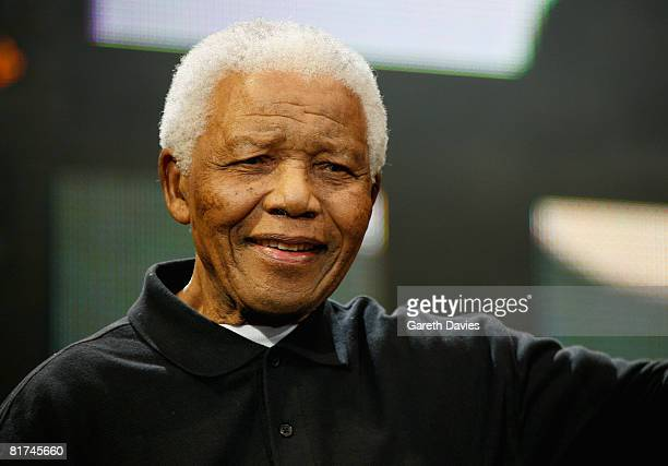 Nelson Mandela poses onstage during the 46664 Concert In Celebration Of Nelson Mandela's Life held at Hyde Park on June 27 2008 in London England