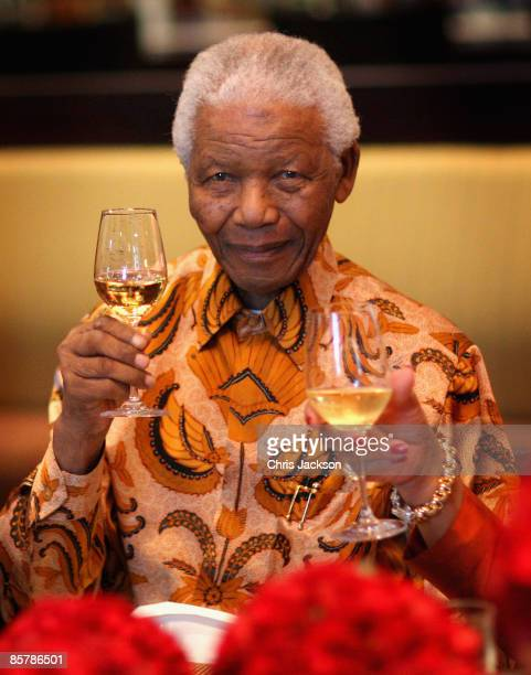 Nelson Mandela raises a glass during a lunch to Benefit the Mandela Children's Foundation as part of the celebrations of the opening of the new...