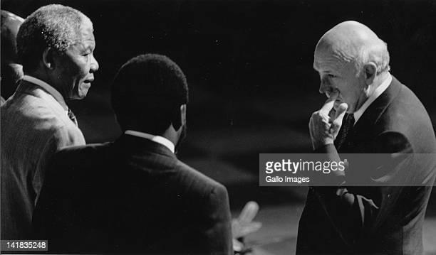 Nelson Mandela talks to FW de Klerk with Cyril Ramaphosa during CODESA talks