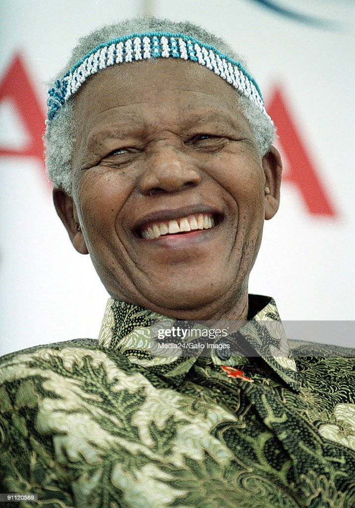 <a gi-track='captionPersonalityLinkClicked' href=/galleries/search?phrase=Nelson+Mandela&family=editorial&specificpeople=118613 ng-click='$event.stopPropagation()'>Nelson Mandela</a> with a headdress given to him by prospective students of the Mngazi School near Umtata, South Africa.