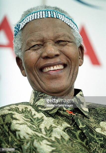 Nelson Mandela with a headdress given to him by prospective students of the Mngazi School near Umtata South Africa