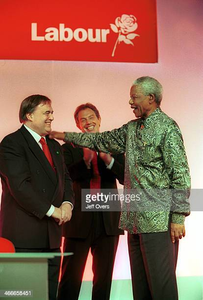 Nelson Mandela with John Prescott and Tony Blair at the Labour Party conference 2000 Former South African President Nelson Mandela with the British...