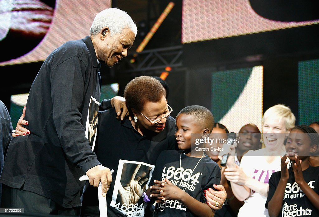 Nelson Mandela with wife Graca Machel onstage during the 46664 Concert In Celebration Of Nelson Mandela's Life held at Hyde Park on June 27, 2008 in London, England.