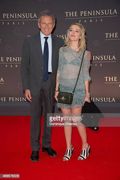 Nelson Monfort and his daughter Victoria attend the The Peninsula Paris Photocall Opening Ceremony on April 16 2015 in Paris France