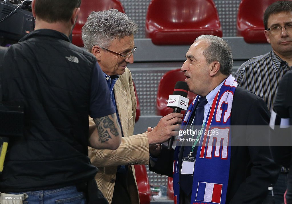 Nelson Monfort of France Televisions interviews Jean Gachassin, president of the French Tennis Federation (FFT) on day one of the Davis Cup first round match between France and Israel at the Kindarena stadium on February 1, 2013 in Rouen, France.