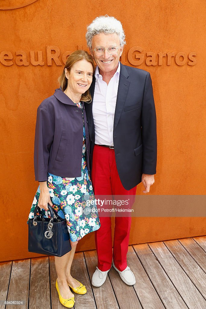 Nelson Monfort with his wife Dominique attend day four of the French Tennis Open at Roland Garros on May 25, 2016 in Paris, France.