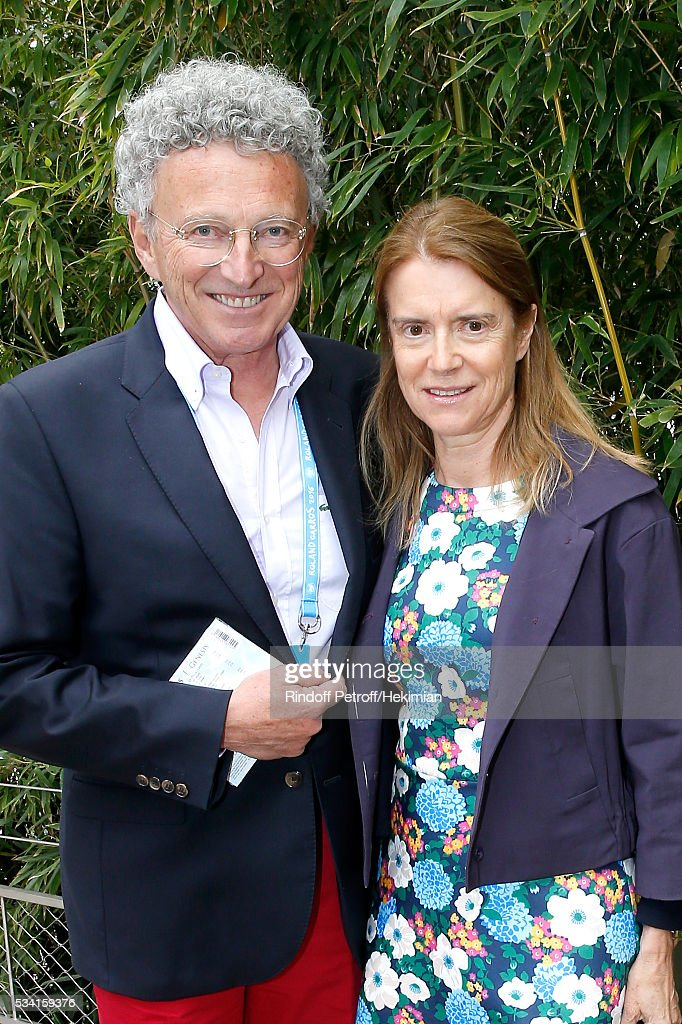 Nelson Monfort with his wife Dominique attend the 2016 French Tennis Open - Day Four at Roland Garros on May 25, 2016 in Paris, France.